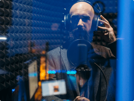 man in recording booth