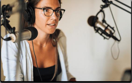 woman in recording studio with headphones on