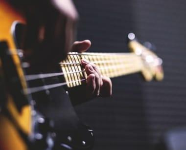 Musician Playing Fender Bass